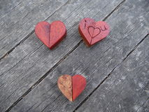 Macro Photograph of Several Wooden Hearts Royalty Free Stock Image