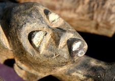 Macro photograph of a statue with the face of a woman carved fro Royalty Free Stock Images