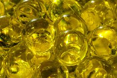 Macro photography Close-up Gel balls in a transparent package Ye. Llow  shiny water gel balls. Macro photo can be used both for advertising or cosmetics Royalty Free Stock Photography