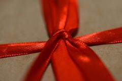 Macro photography. Close - up of red bow and ribbons from gift craft packaging. stock image