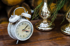 Macro photography decoration items. Clock in the snow on a table Stock Image