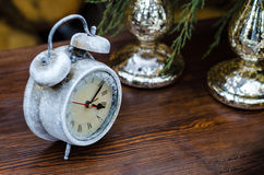 Macro photography decoration items. Clock in the snow on a table Stock Photo