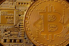 Macro photography of a golden yellow metal bitcoin. Close up shiny metal texture. Abstract business and modern technology backgro Stock Photo