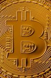 Macro photography of a golden yellow metal bitcoin. Close up shiny metal texture. Abstract business and modern technology backgro. Und. Cryptocurrency mining stock photos