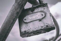 Macro Photography of Gray Metal Padlock on Gray Metal Bar Royalty Free Stock Photography