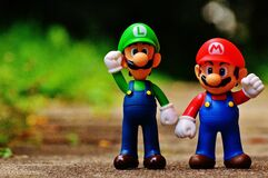 Macro Photography of Mario and Luigi Plastic Toy Royalty Free Stock Photography
