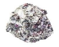 Corundum crystals in rough gneiss rock on white royalty free stock photography