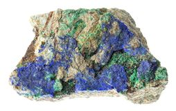 Raw Azurite and Malachite on stone on white. Macro photography of natural mineral from geological collection - raw Azurite and Malachite crystals on stone on stock images
