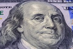 Macro photography Portrait of Benjamin Franklin on banknote one hundred american dollars. Close up view stock photo