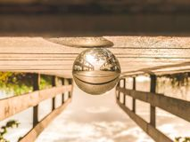 Macro Photography of Round Glass Ball on Top of Brown Wooden Dock stock photos