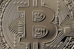 Macro photography of a silver bitcoin. Close up shiny metal texture. Abstract business and modern technology background. Cryptocu. Rrency mining concept stock photos
