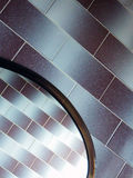 Macro photography of wall tiles and mirror. Bright detail photo of glossy wall tiles and oval mirror royalty free stock photos