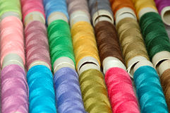 Macro pic: assorted colors reels of thread 3. Macro shot with  assorted colors reels of thread Stock Image