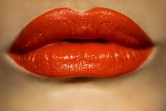Macro picture of female lips with red lipstick royalty free stock photography