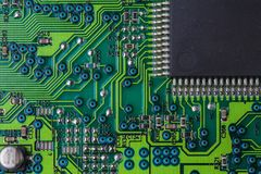 Macro picture of green printed circuit board - PCB. Macro picture of red printed circuit board with chips Stock Image