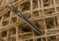 Macro picture of sewing needle in clew Stock Photo
