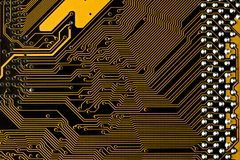 Macro picture of yellow printed circuit board - PCB texture. Macro picture of yellow printed circuit board with chips Royalty Free Stock Photography