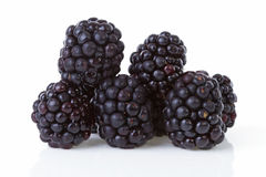 Macro of pile blackberries over white background Stock Image