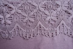 Macro of pink fabric with lace. Macro of pink viscose fabric with lace Royalty Free Stock Photo