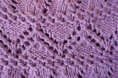 Macro of pink handmade zigzag knitted openwork Stock Photos