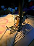 Presser foot of sewing machine. Sewing work in progress. royalty free stock photography