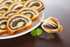 Macro of Poppy seed roll slices and half pod Royalty Free Stock Photos