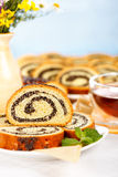 Macro of poppy seed roll slices and tea Stock Image