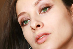 Macro portrait of beautiful girl with green eyes Royalty Free Stock Images
