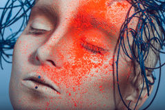 Macro portrait of woman with neon powder on face Stock Image