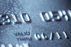 Macro pousse d'un par la carte de crédit Photos stock