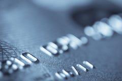 Macro pousse d'un par la carte de crédit Photos libres de droits
