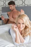 Macro Pretty Young Couple on Bed Looking at Camera Royalty Free Stock Image