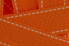 Macro primo piano della cinghia arancio della cinghia come fondo Fotografia Stock