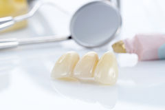 Macro of prosthetic teeth with dental tools Royalty Free Stock Photos