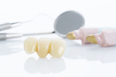 Macro of prosthetic teeth with dental tools Stock Photos