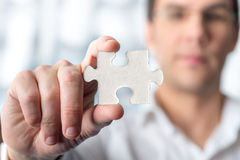 Macro Puzzle Piece Hold by Man Royalty Free Stock Photos