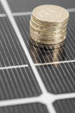 Macro PV Solar Panel and money. Royalty Free Stock Images