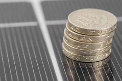 Macro PV Solar Panel and money. Stock Image
