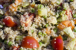 Macro of quinoa salad with tomatoes and vegetables. As food royalty free stock photo