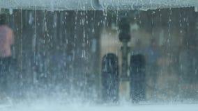 Macro Rain Drops Fall against Landing Gear stock footage