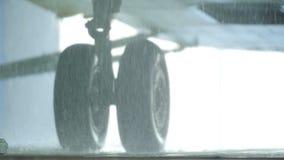 Macro Rain Drops Fall by Helicopter Landing Gear stock video