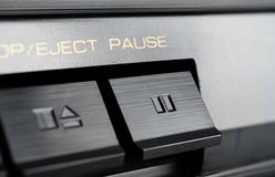 Macro Of A Rectangular Pause Button Of An Old Hifi Stereo Audio System. Macro Of Rectangular Pause Button Of An Old Hifi Stereo Audio System royalty free stock photos