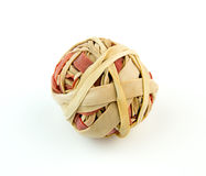 Macro of red and brown rubber bands in a ball. Isolated on white stock photography