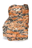 Macro of red coarse-grained granite rock isolated on white background. Piece of the red granite which is widely used in construction stock photo