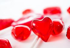 Macro red heart with chocolates and lollipops on white background Royalty Free Stock Image