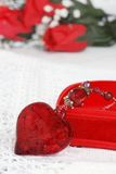 Macro red heart jewelry leaning on box