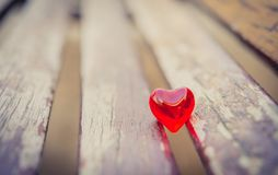 Macro red heart on a vintage wooden chair Stock Images