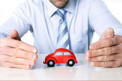 Macro red toy car and businessman hands Royalty Free Stock Photo