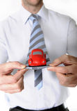 Macro red toy car in businessman necktie Stock Photos