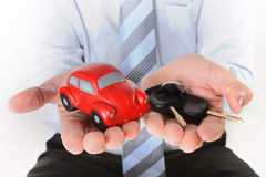 Macro red toy car with car keys in mans hand Royalty Free Stock Image